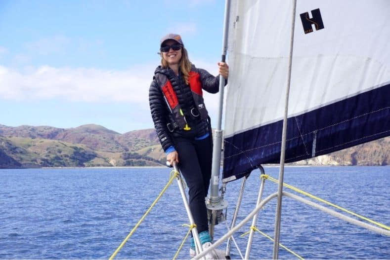 Person holding sail on a monohull
