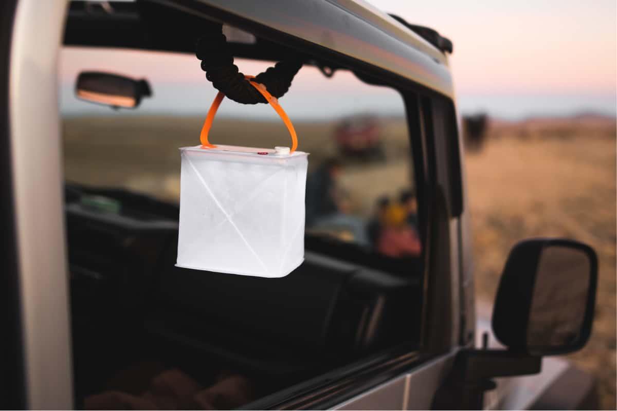 The best solar camping lantern hanging inside a truck window