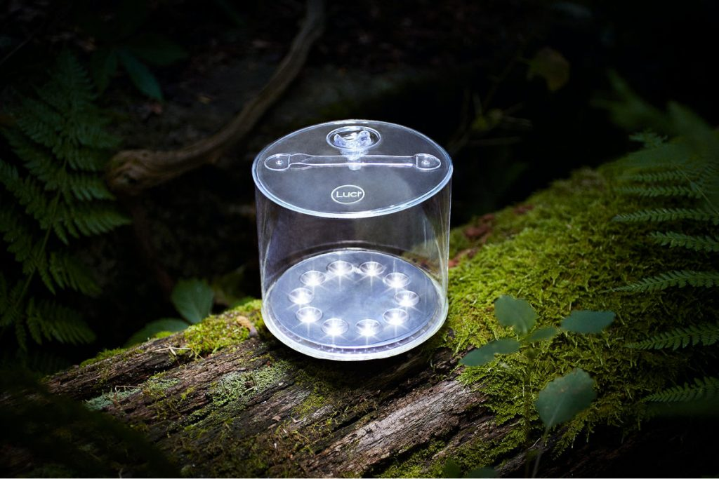 M Powered Luci Best Solar Camping Lantern on a mossy log