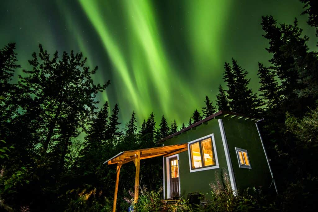 A tiny house with the aurora borealis in winter, the time you'll need the right tiny house heater