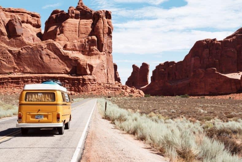 Vintage camper van driving along the road