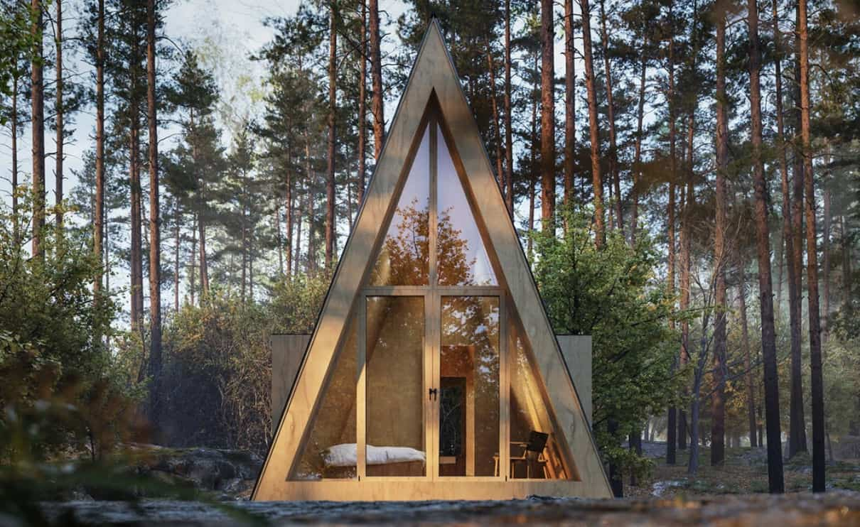 A frame tiny house parked in the woods