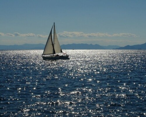 Sailboat on deep blue water