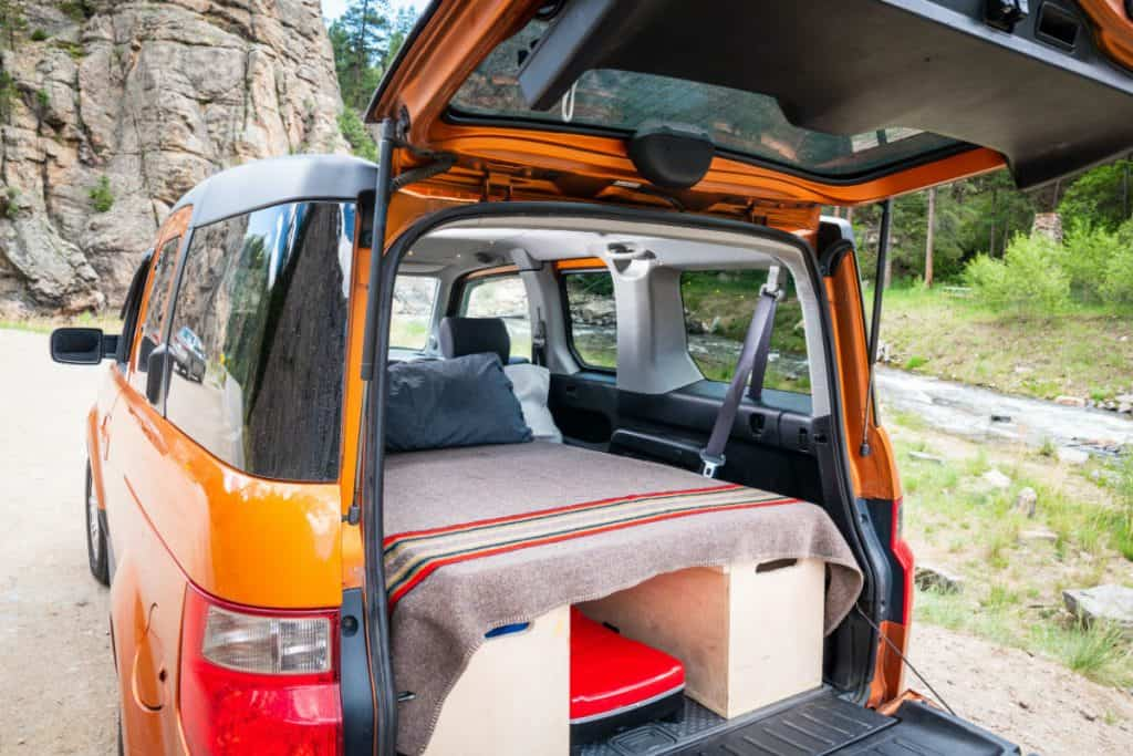 Bed and storage inside a DIY Honda Element Camper conversion