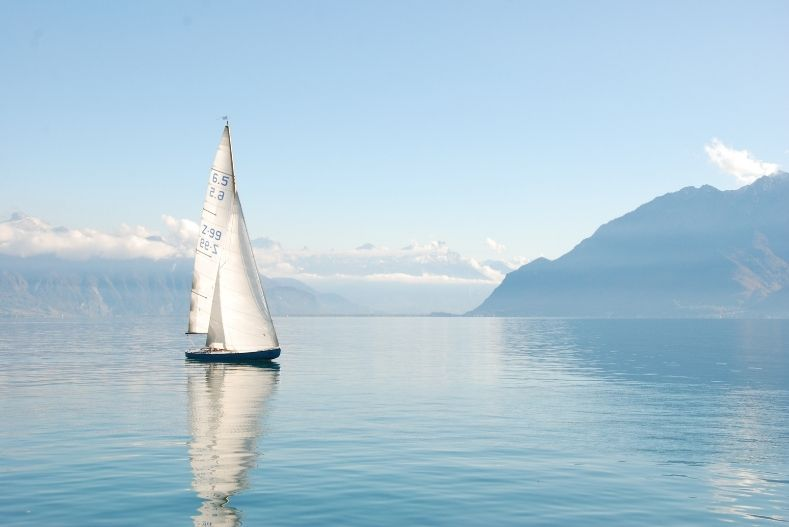 Sailboat on pale blue waters