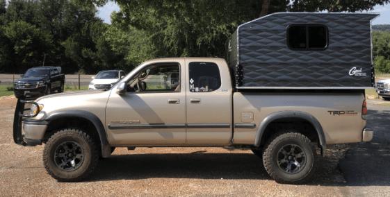 Capri Cowboy best slide in camper for small trucks on a tan pickup
