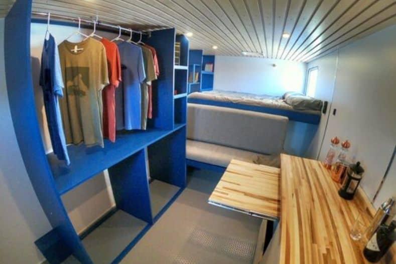 Contravans conversion interior showing bed, countertop and clothing storage