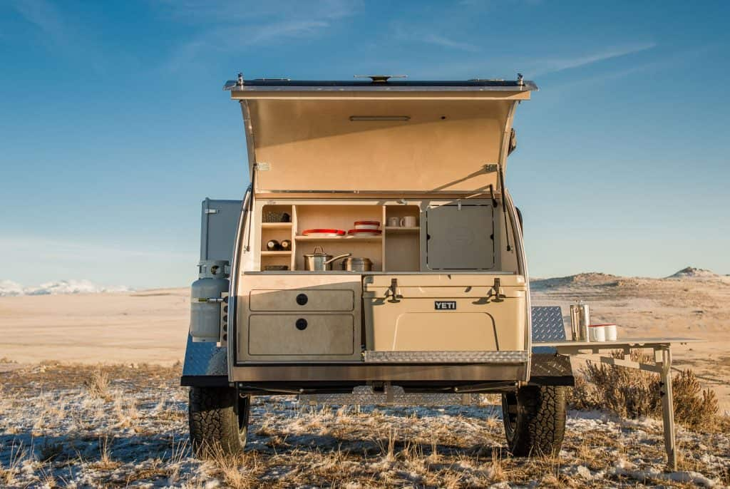 The Escapod teardrop trailer offers a gourmet outdoor galley for cooking on the go.