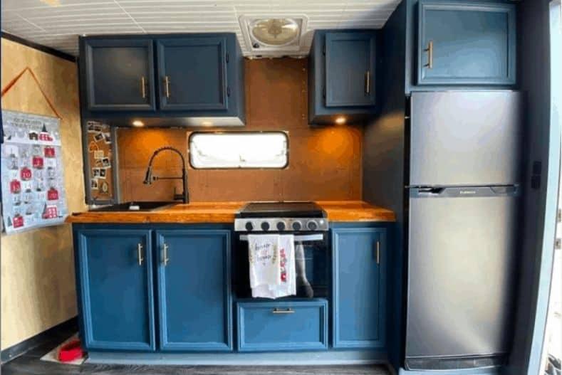 Luke and Sarah's box truck conversion interior kitchen view