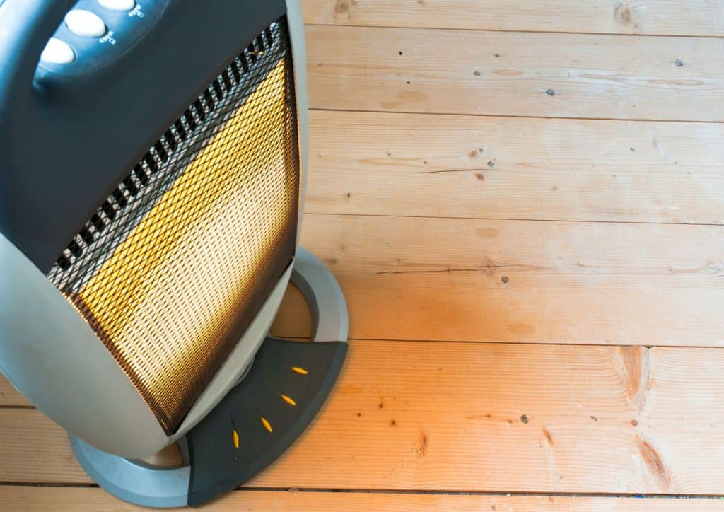An RV electric heater on a wooden floor
