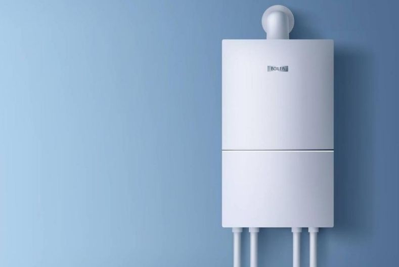 Tankless water heater mounted on blue wall