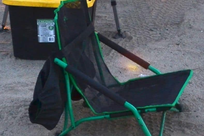 Green and black lost camp chair is a must for truck camper supplies