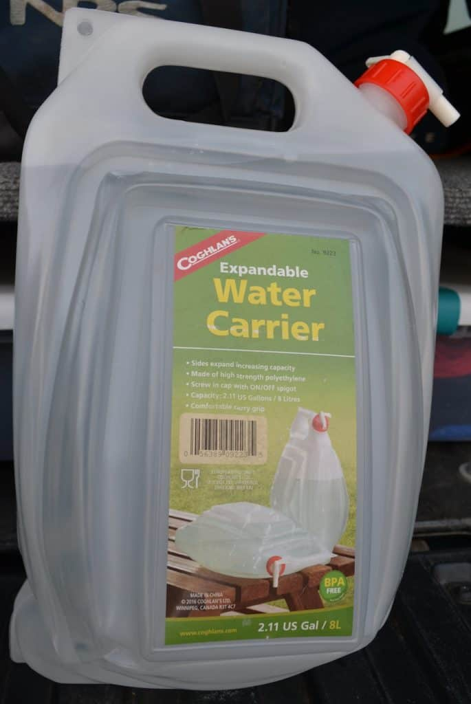 Expandlable 2 gallon water carrier as part of a truck camper supplies list