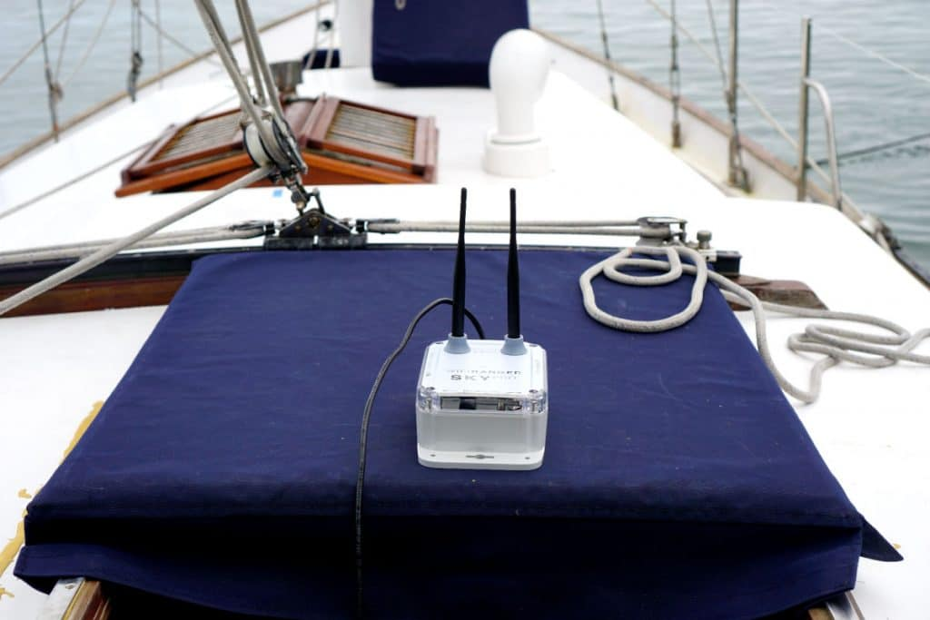 WiFi ranger perched on our hatch helps with connectivity when living on a sailboat