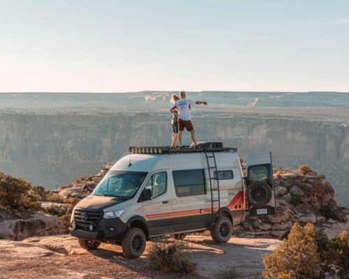 4x4 camper van for sale parked on the edge of a desert precipice