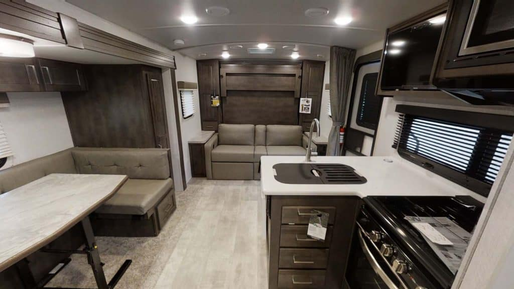 Rockwood small travel trailer with slide out interior with kitchen and couches