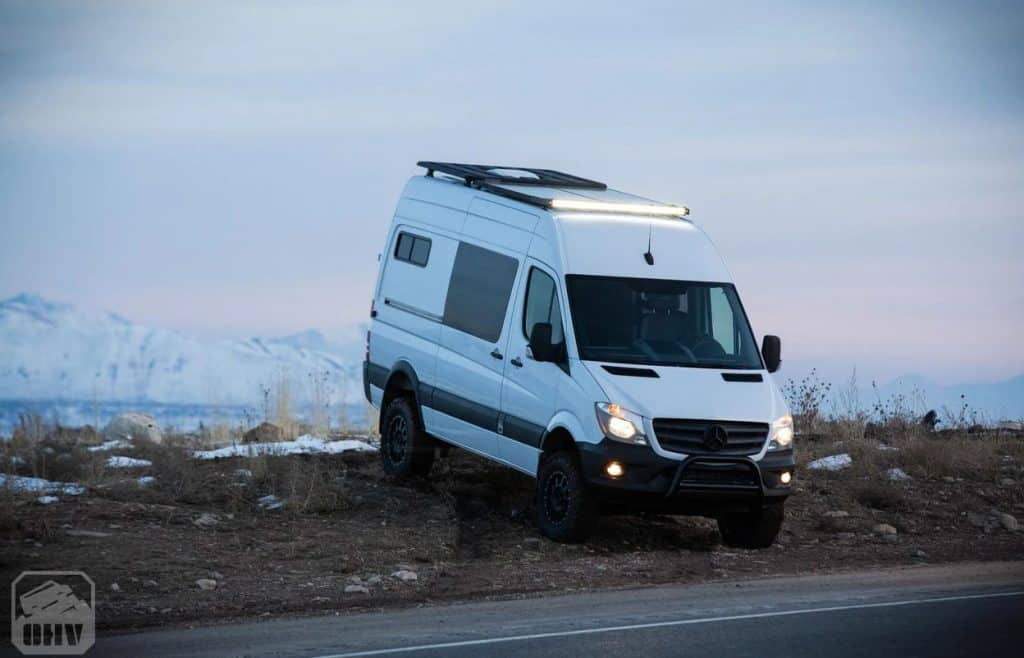 4x4 camper van for sale driving on the road shoulder
