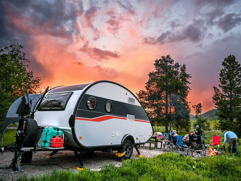 The TAB best teardrop trailer parked in the forest at sunset