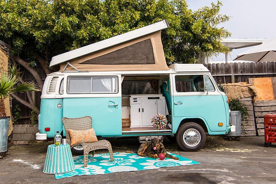 Bright blue VW camper van rental for road trip