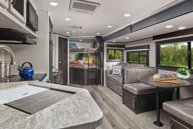 Jayco Jay Feather interior with kitchen, dinette, couch and bunks