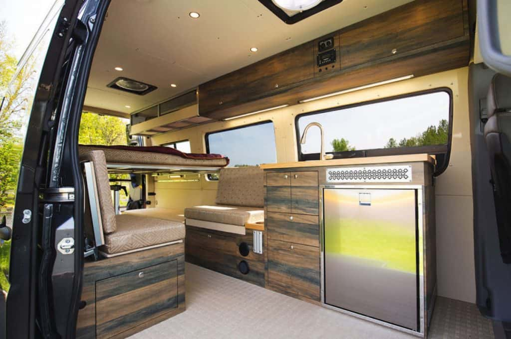 Outside van 4x4 camper interior with kitchen, benches and bed