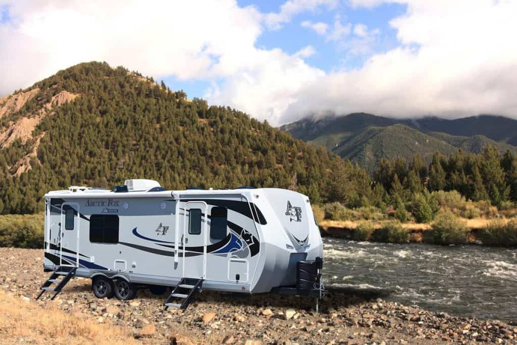 Arctic Fox best 4 season travel trailer parked by a rover