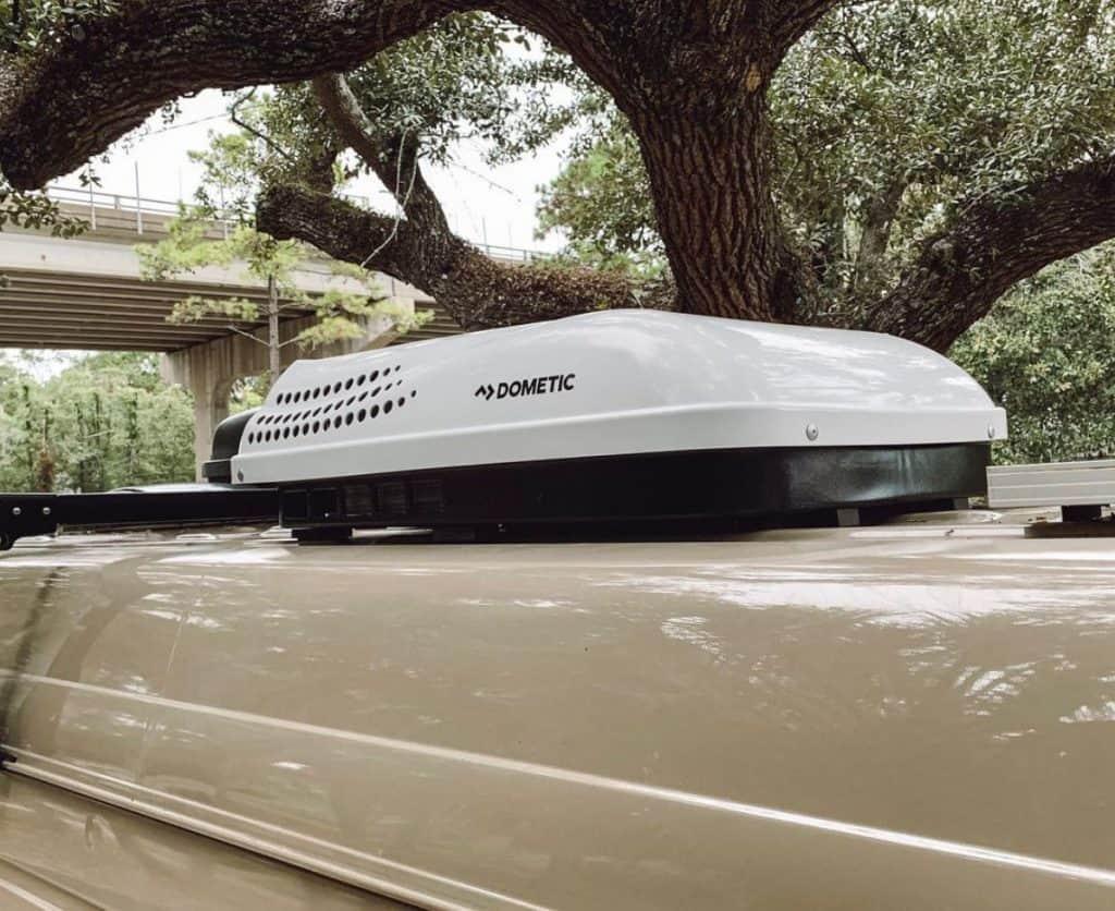 campervan air conditioner on top of tan Sprinter van