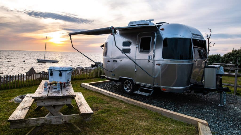 Airstream Caravel best travel trailer under 6000 lbs parked overlooking the ocean