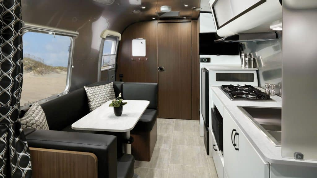 Interior of the Airstream 6000 lbs camper including sitting area and kitchen