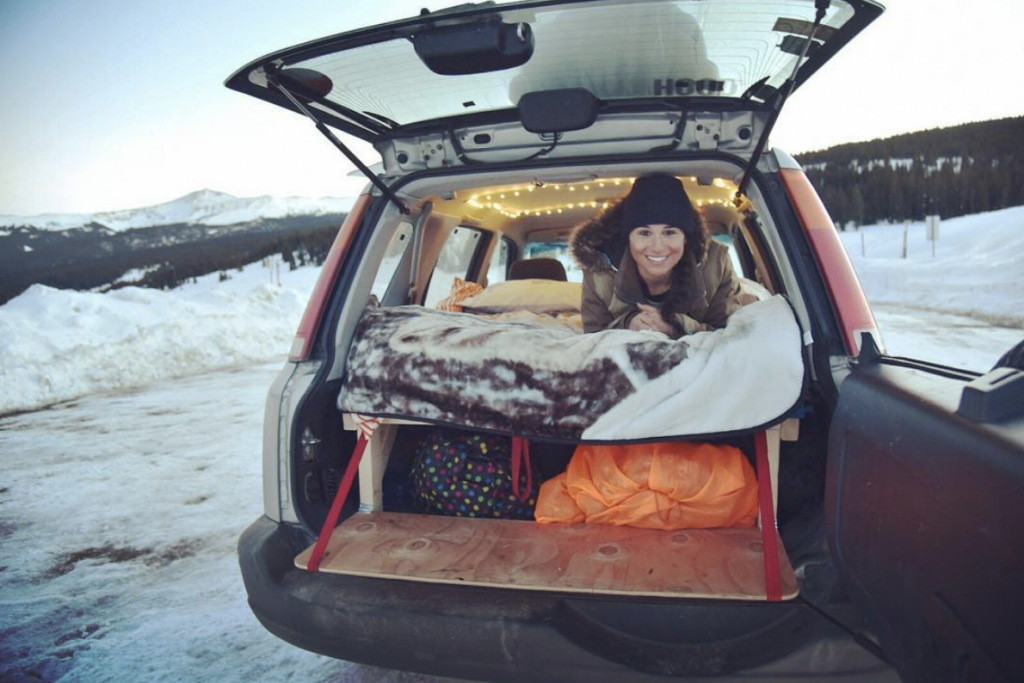 Tiny CRV SUV camper with bed platform and storage