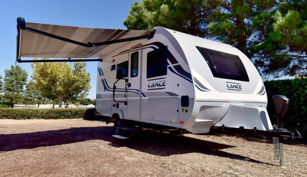 The Lance best 4 season travel trailer parked in a campground