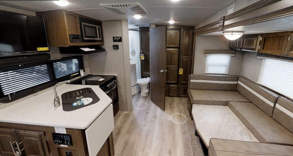 Interior of the Micro Lite 6000 lbs camper interior with couch and kitchen area