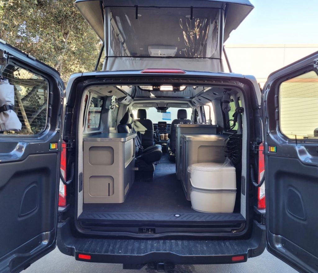 Interior of a Modvans Ford Transit RV conversion, a pop top camper van