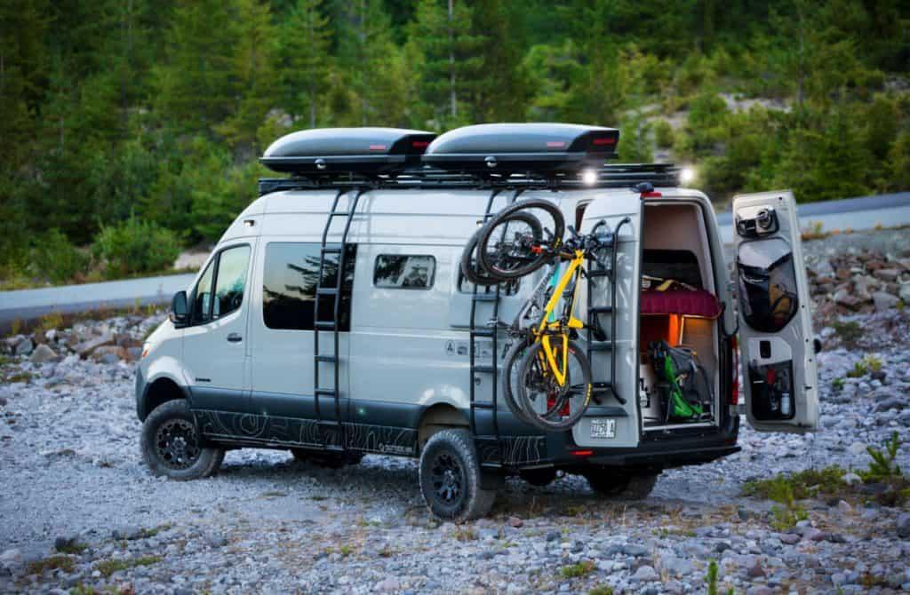 A gray Sprinter Van conversion by Outside Van Sprinter Van Conversion company