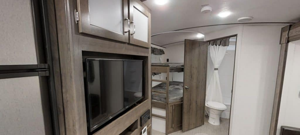 Passport 6000 lbs camper interior showing bathroom and bunk beds