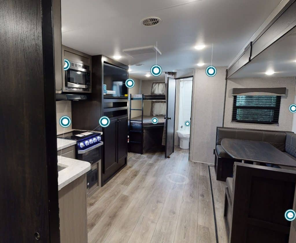 Interior of the Starcraft 6000 lb travel trailer with kitchen and dinette