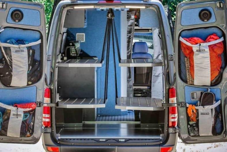 Outside van conversion showing two sets of campervan bunk beds