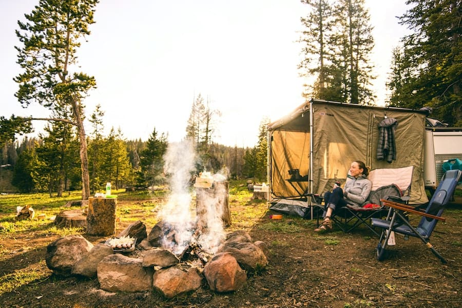 Woman enjoying a dispersed campsite in a national forest