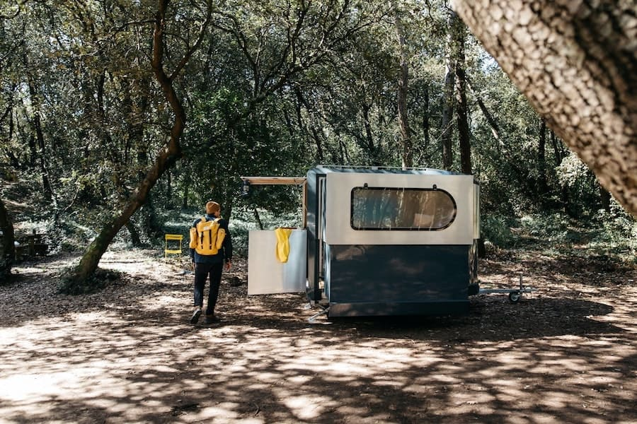 National Forest Camping - a dispersed campsite with an RV and a man