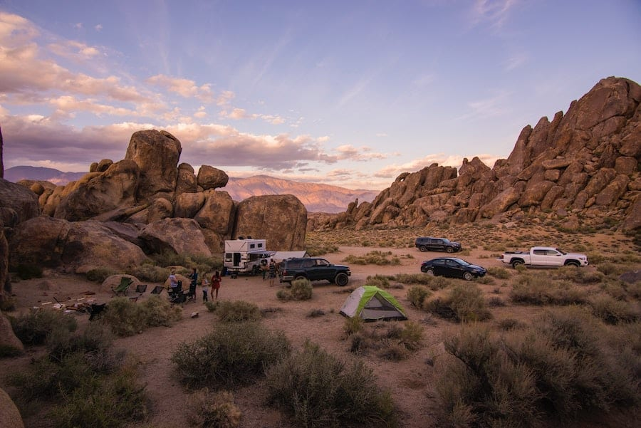truck campers and tents dispersed camping in a national forest