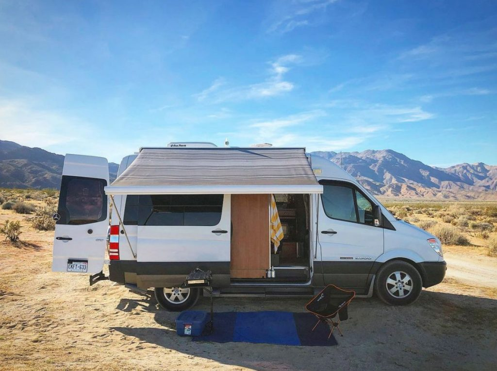 A white campervan in a free California campsite at Anza Borrego
