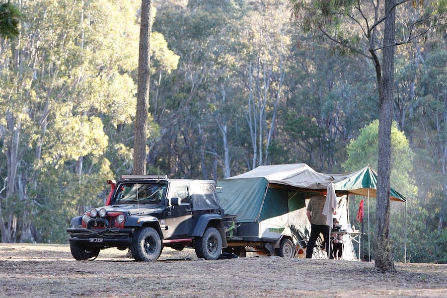 A jeep and a trailer dispersed camping in a national forest