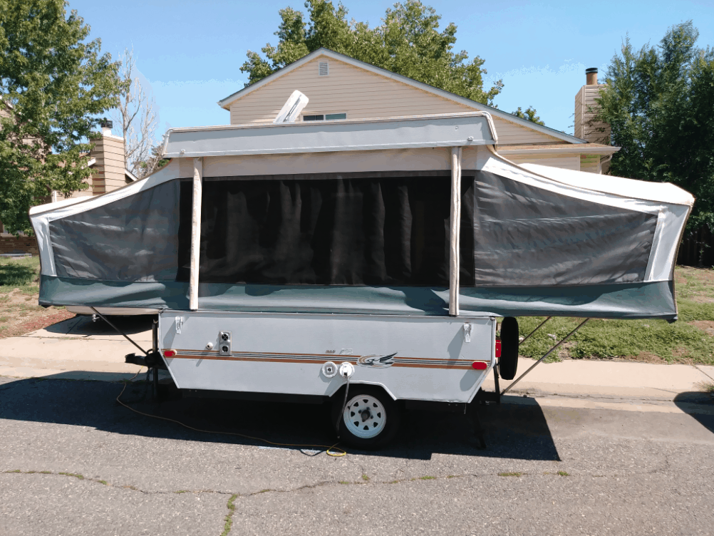 Pop up camper rental with sides folded out