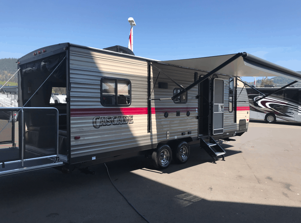 Toy hauler camper trailer for rent with awning extended