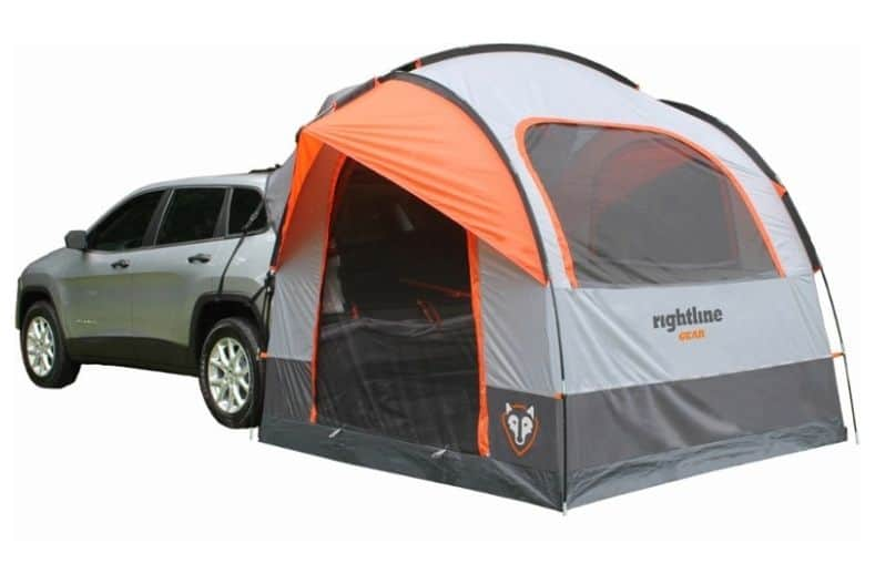 Orange and grey Rightline minivan tent attached to an SUV