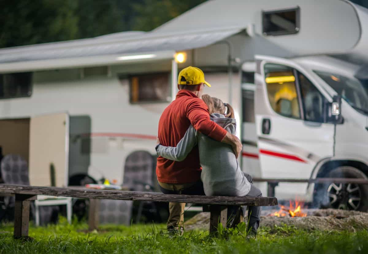 Father and child sitting outside best rv for family of 4