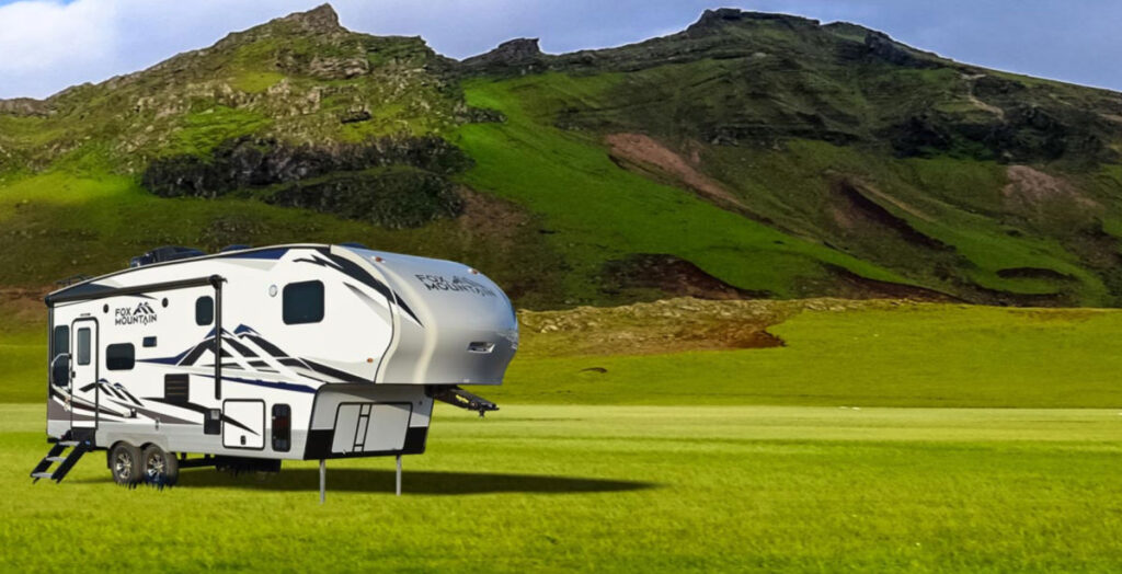 Northwood small 5th wheel camper parked in a field