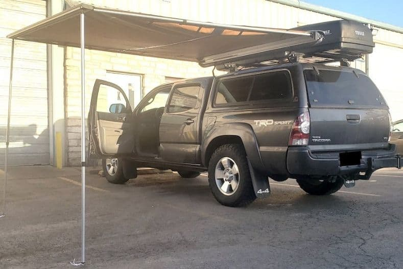 Truck with rooftop mounted awning set up
