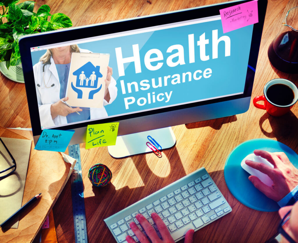Person looking through health insurance options