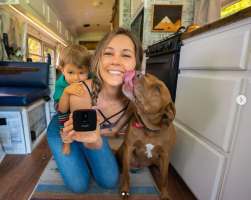 woman using Waggle pet temperature monitor in her RV